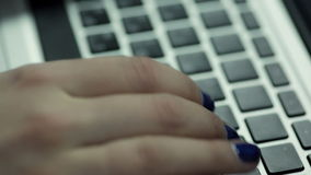 Woman hand typing on laptop keyboard stock video
