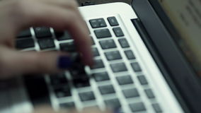 Woman hand typing on laptop keyboard stock video footage