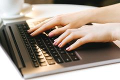 Woman hand typing on laptop keyboard royalty free stock photo