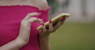 Woman hand typing mobile message on screen smartphone. Close up female hands holding smartphone and browsing website. Woman hand typing message on screen stock footage