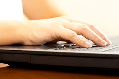 Woman hand typing on the notebook Stock Photos
