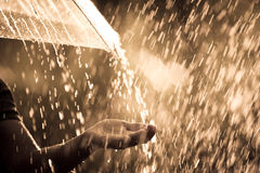 Woman hand with umbrella in the rain royalty free stock photo