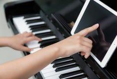 Woman hand use tablet Stock Photos