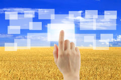 Woman hand uses touch screen interface Royalty Free Stock Photography