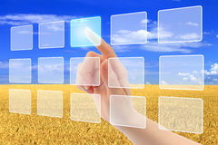 Woman hand uses touch screen interface Royalty Free Stock Photos