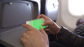 Woman Hand using cell phone in Airplane stock footage