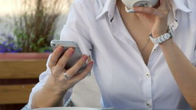 Woman hand using a smart phone during breakfast in cafe with coffee stock video