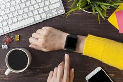 Free Woman Hand Using Smartwatch On Office Desk, Top View Stock Image - 160817951