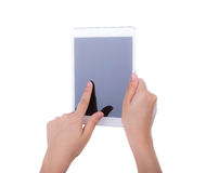 Woman hand using a touch screen device Stock Photo