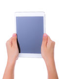 Woman hand using a touch screen device Stock Image