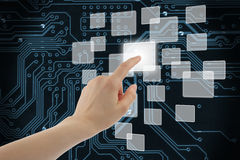 Woman hand using touch screen interface. On circuit board background Stock Photos