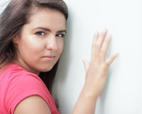 Woman with hand on the wall Stock Photos