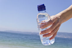 Woman hand with a water bottle Royalty Free Stock Image