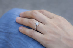 A woman hand. Wearing a diamond ring Stock Image