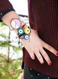 Woman hand wearing stylish evil eye bracelets Royalty Free Stock Images