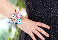 Woman hand wearing stylish evil eye bracelets Royalty Free Stock Image