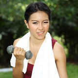 Woman with hand weights. Royalty Free Stock Image