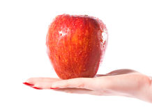 Woman hand with wet red apple Royalty Free Stock Photography