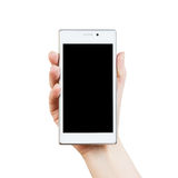 Woman hand with white smartphone Royalty Free Stock Image