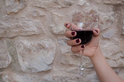 Woman hand with wine Royalty Free Stock Photo