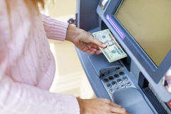 Woman hand withdrawing money from outdoor bank ATM Royalty Free Stock Photos