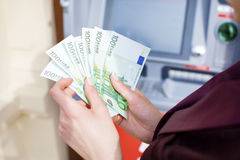 Woman hand withdrawing money from outdoor bank ATM Royalty Free Stock Images