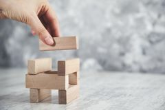 Woman hand wooden cubes on table stock images