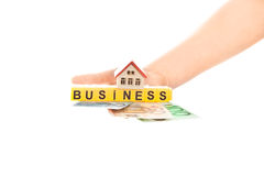 Woman hand with word business and house with euro Royalty Free Stock Image