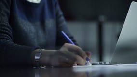 Woman hand write and typing on laptop keyboard. Closeup of business woman hand write and typing on laptop keyboard stock video