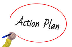 Woman hand writing action plan with marker. On white background Stock Photo