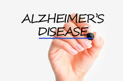 Woman hand writing Alzheimer's disease on screen Royalty Free Stock Image