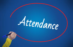 Woman hand writing attendance with marker stock image