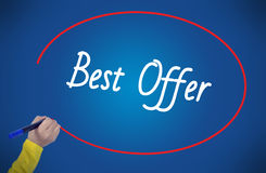 Woman hand writing best offer with marker. On blue background professionally Stock Photo