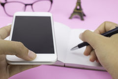 Woman hand writing on blank notebook Royalty Free Stock Image