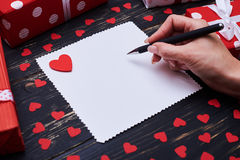 Woman hand writing on a blank sheet of paper with a pencil Royalty Free Stock Photo