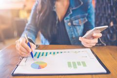 Woman hand writing on charts and graphs that show results with a royalty free stock photos