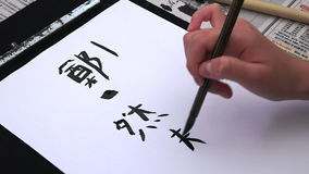 Woman hand writing Japanese calligraphy stock video footage