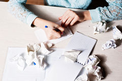Woman hand writing with pen on notebook.there are crumpled paper Royalty Free Stock Photography