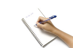 Woman hand writing with pen on notebook Stock Photo