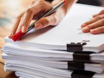 Woman hand writing on stack of paper. business and education co royalty free stock photography