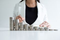 Woman hand writing coins from her coins bar graph royalty free stock photos