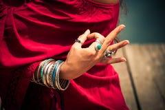 Woman hand in yoga symbolic gesture mudra Royalty Free Stock Image