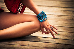 Woman hand in yoga symbolic gesture mudra outdoor Royalty Free Stock Image