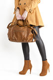 Woman with a handbag Stock Images