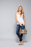 Woman with handbag Stock Photos
