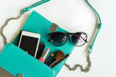 Woman handbag with makeup, cellphone and accessories. On white background, Fashion concept Royalty Free Stock Photo