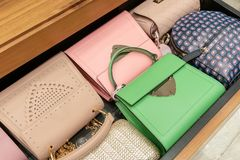 Woman handbag in a showcase of a luxury store. Royalty Free Stock Image