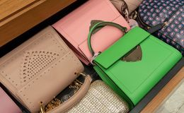 Woman handbag in a showcase of a luxury store. Stock Images
