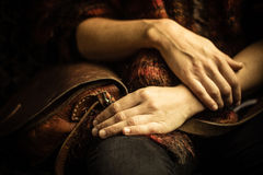 Woman with handbag sitting on old vintage sofa Royalty Free Stock Images