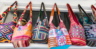 Woman handbags in a row Royalty Free Stock Image